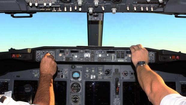 Article image for Qantas bans pilots having facial hair and wearing backpacks