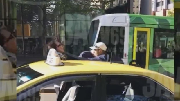 Article image for WATCH: Melbourne taxi driver insulted and abused by two men in Melbourne's CBD
