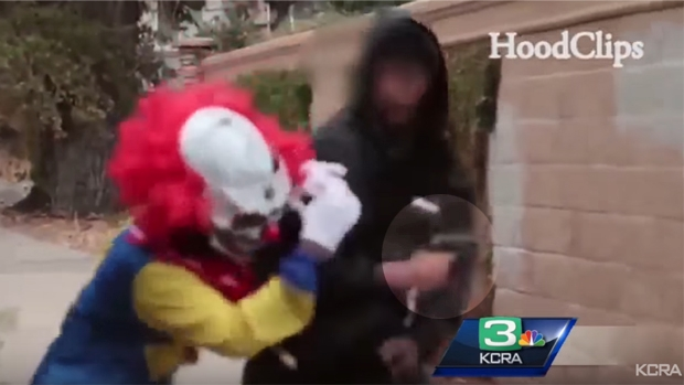 Article image for Scary clown prank goes wrong after prankster has a gun pointed at his face