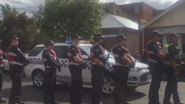 Article image for Dozens of police move in on Bendigo Street squatters