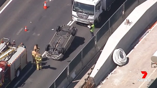 Article image for Car flips on West Gate Freeway