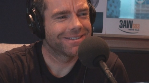 Article image for Cadel Evans discusses his new book with Neil Mitchell in studio