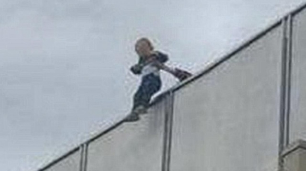 Article image for Senior Constable interviewed after baby held over Cremorne balcony on Melbourne Cup day