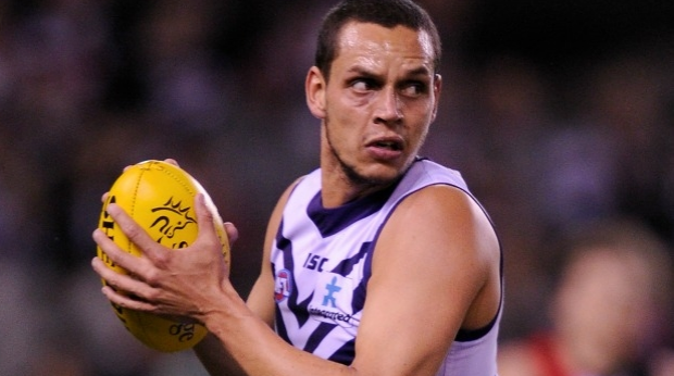 Article image for Fremantle defender Michael Johnson allegedly assaults man outside kebab shop