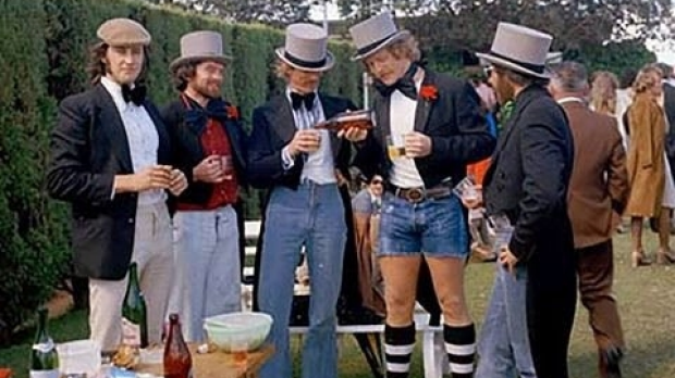 Article image for The hunt is on for group of dapper men pictured at the 1974 Melbourne Cup