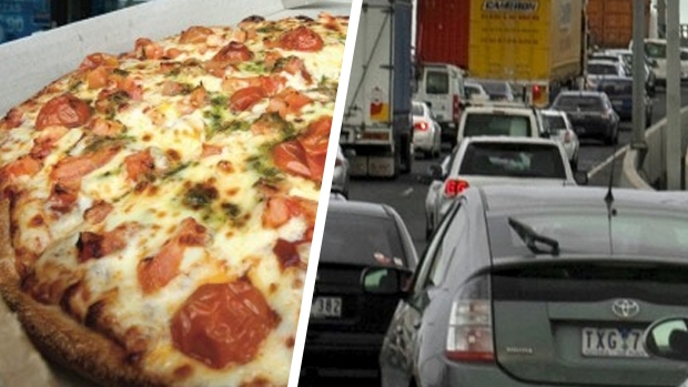 Article image for Woman orders pizza for busload of kids stuck in traffic on the Princes Freeway