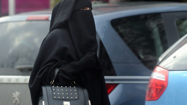 Article image for Liberals outline plan to penalise people for covering their face in court