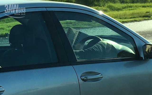 Article image for Man spotted reading a restaurant menu at 100km/h on the Princes Highway