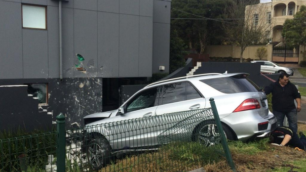 Article image for Man, 80, crashes luxury car into Toorak home