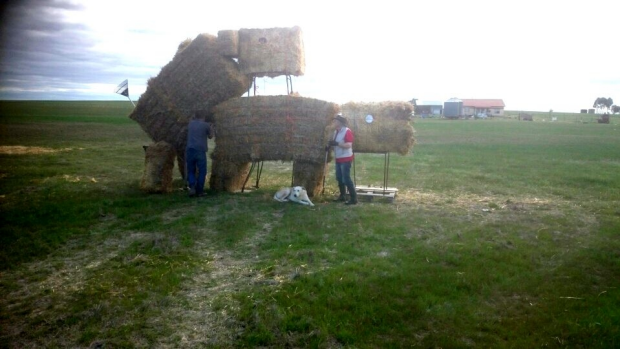 Article image for Controversial hay bale sculpture to be rebuilt after being set on fire
