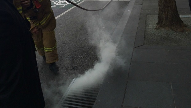 Article image for Mysterious smoke rising from a drain in the city