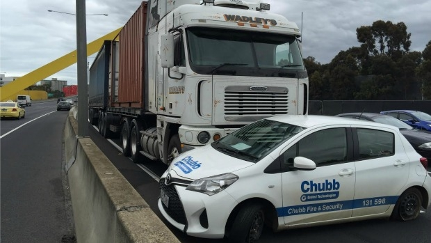 Article image for Car stuck under truck on Tullamarine Freeway