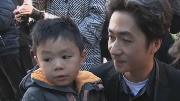 Article image for French father comforts young son in moving video after Paris terror attacks
