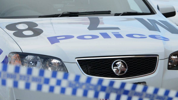 Article image for Two men robbed a family at gunpoint early Sunday morning at Ivanhoe East