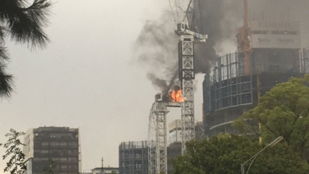 Article image for Crane bursts into fire, collapses on St Kilda Rd