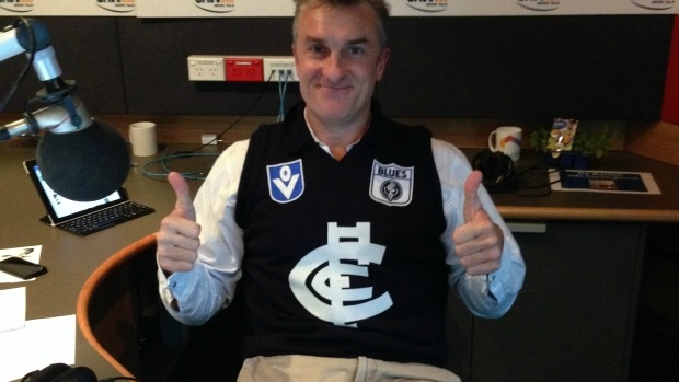 Article image for Is it OK for an adult to wear a football guernsey? Tom Elliott told he shouldn't