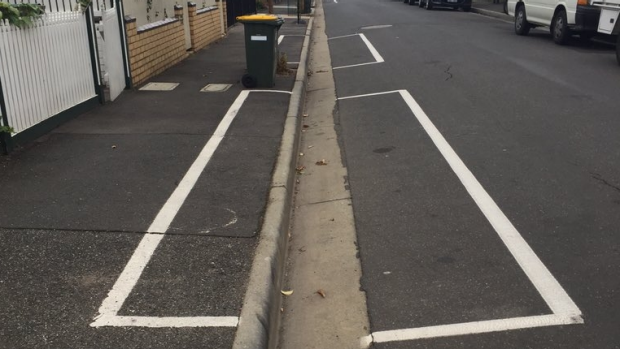 Article image for Tensions in Abbotsford as council paints parking bays on the footpath