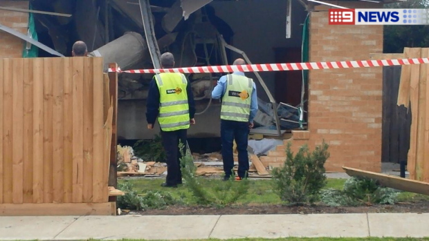 Article image for Driver killed after his truck crashes into a home at Apollo Bay