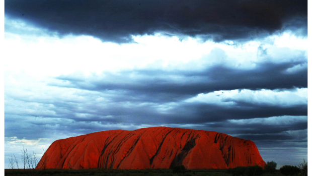 Article image for Indigenous communities upset the government won't ban climbing Uluru