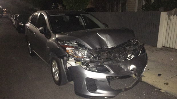 Article image for A gun found in an alleged stolen BMW that crashed into three cars at Northcote