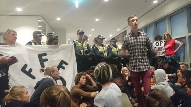 Article image for Protesters occupy Department of Immigration offices on Lonsdale Street
