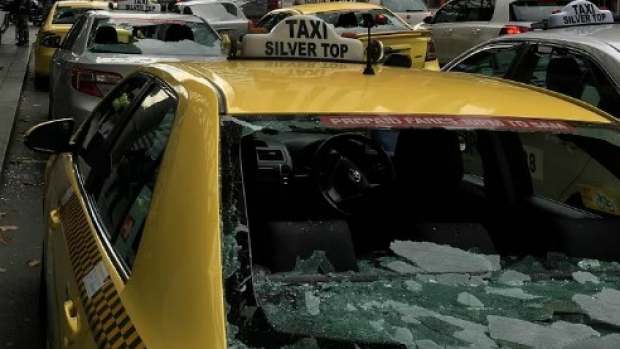 Article image for Man with cricket bat smashes taxi windows on Spencer Street