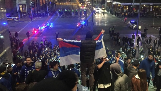 Article image for Soccer fan 'intimidated' by police for wearing a flag