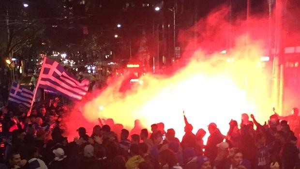 Article image for Soccer fans set off flares in Melbourne's CBD last night
