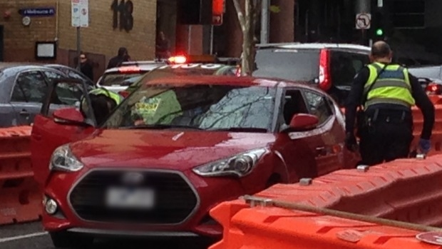 Article image for WATCH: Police tackle woman who flees car after bizarre CBD chase