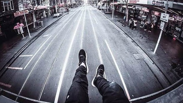 Article image for RUMOUR CONFIRMED: Fare evader sits on roof of Swanston Street tram and takes pictures