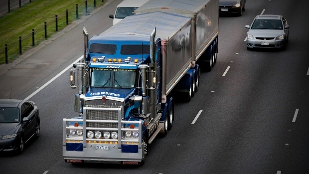 Article image for Speed limit for trucks on Monash Freeway drops to 90km/h under trial