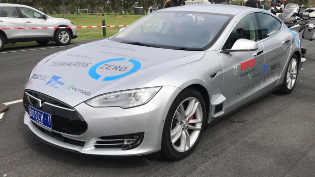 Article image for Neil Mitchell takes a Bosch enhanced 'Tesla' driverless car out for a drive at Albert Park