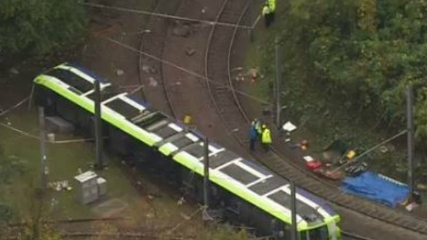 Article image for At least 7 die, dozens injured after tram derails in Croydon, London