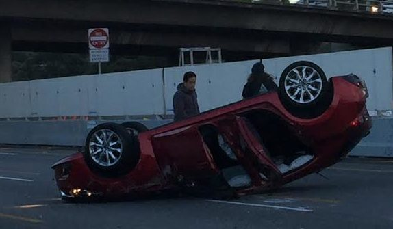 Article image for Car flips on the Monash Freeway inbound at Stud Road