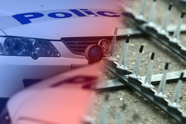 Article image for Unlucky driver left in prickly mess after road spikes fell from police car at Fawkner