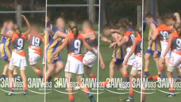 Article image for Confronting junior footy clash captured on camera