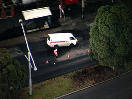 Article image for Van plunges into massive Port Melbourne pothole