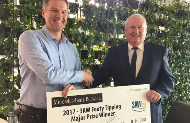 Article image for This year's footy tipping winner picks up his prize!
