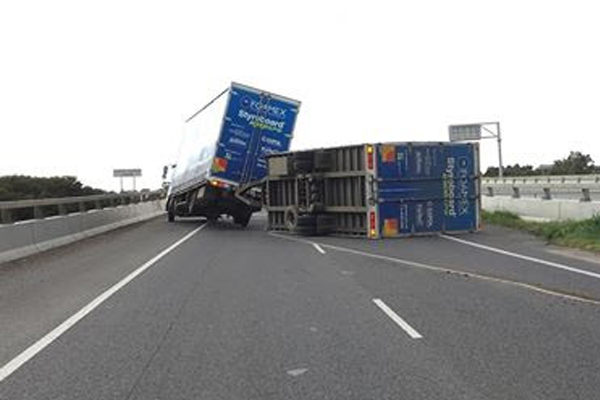 Article image for Truck flips as Melbourne prepares for wild and windy day