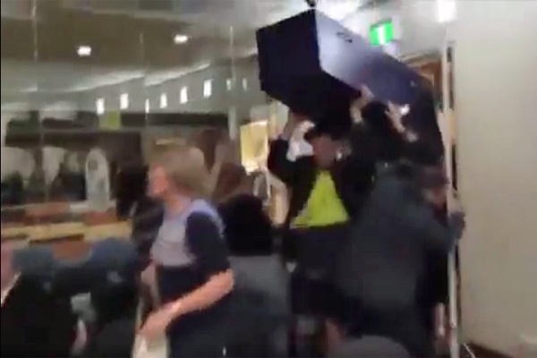 Article image for Councillors flee as coffin-bearing protesters storm Moreland meeting