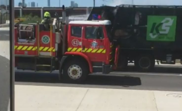 Article image for Bizarre footage emerges of a garbage truck being hosed down while on the move