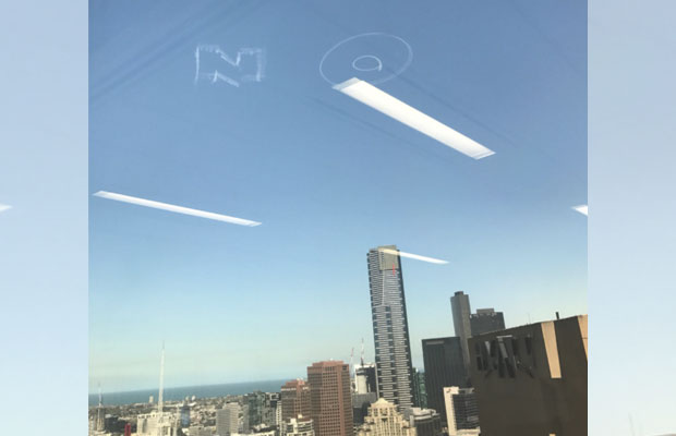 Article image for 'NO' written in the sky above Melbourne