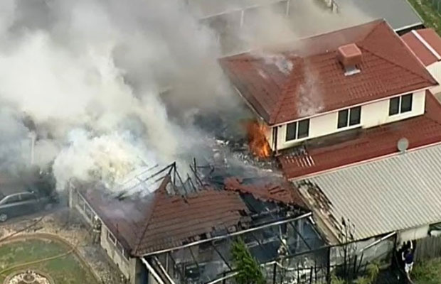 Article image for Schools told to stay inside as house goes up in flames