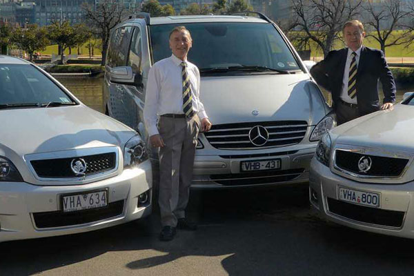 Article image for Hire car operators to lose VH plates in feud with state government
