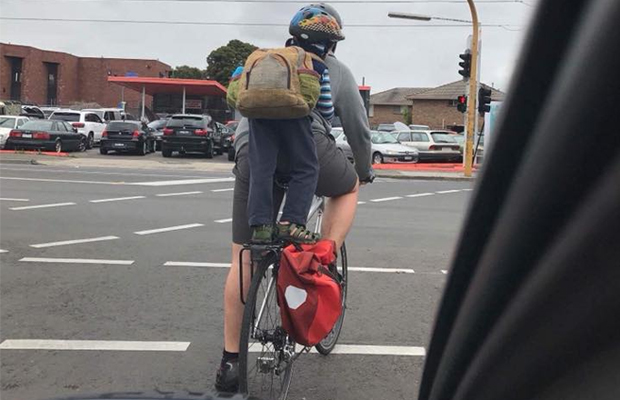 Article image for Cyclist snapped with child standing on the seat
