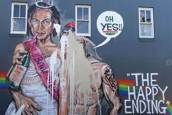 Article image for Mural featuring Tony Abbott and Cardinal George Pell in celebration of 'yes' vote vandalised