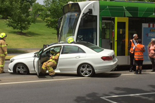 Article image for Trams banked back after car and tram collide on St Kilda Road