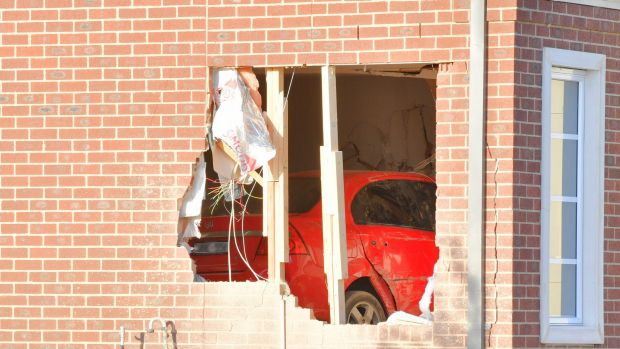Article image for Airborne car crashes into living room of house in Melbourne's west
