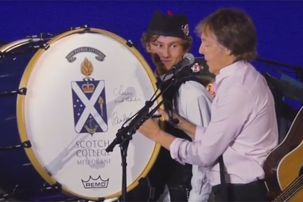 Article image for McCartney signs 16-year-old student's bass drum onstage