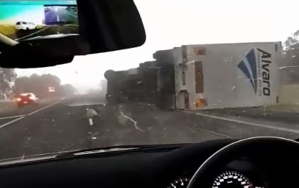 Article image for Wild weather topples truck on the Hume Freeway